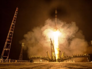 U.S.-Russian Crew Docks With Space Station for Yearlong Mission