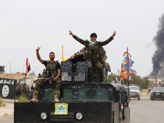 Battle for Tikrit: Iraq Hails 'Magnificent Victory' Over ISIS in Saddam's Birthplace