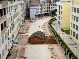 Homeowner Refuses to Budge for Chinese Developer