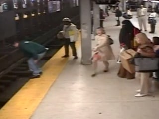 Good Samaritan Leaps Onto Tracks After Platform Plunge