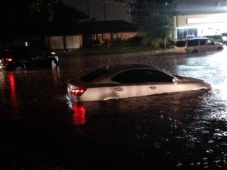 Cars Battle High Waters After Flash Floods in Houston