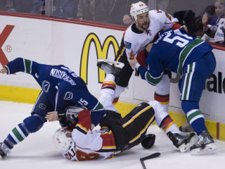 Canucks Ride Crowd to Emotional Win Over Flames