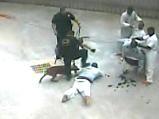 Shocking Jail Video Shows Guard and Dog Attacking Prisoner