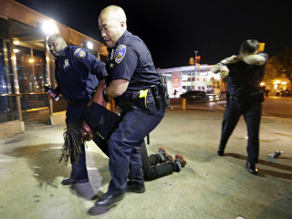 Freddie Gray Case: Police Make Arrests As Curfew Remains in Baltimore