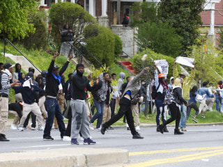 Stones Hurled at Baltimore Police in Protests After Freddie Gray Funeral