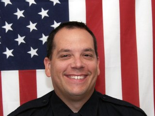 Idaho Cop Greg Moore Dies After Suspect Opens Fire, Steals Patrol Car