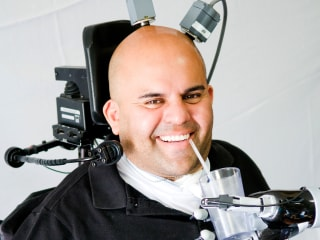 Mind-Controlled Robot Arm Gives New Freedom to Paralyzed Man