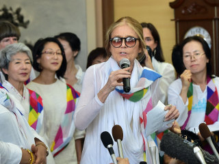 Gloria Steinem, Activists Cross DMZ Dividing Koreas by Bus