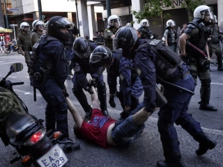 Greek Debt Crisis: Police Use Stun Grenades in Clashes Ahead of Vote