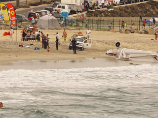 Single-Engine Plane Towing Banner Crashes on California Beach