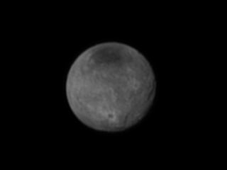 New Horizons Probe Focuses on Pluto's Moon Charon ... and Vader Crater?