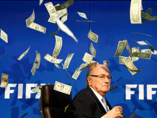 Sepp Blatter, Outgoing FIFA Chief,  Showered With Cash in Stunt