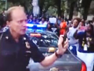 Cleveland Investigating Cop's Use of Pepper Spray on Crowd of Activists Caught on Cellphone