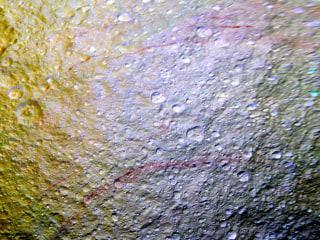 Mysterious Red Arcs Found on Saturn's Icy Moon Tethys