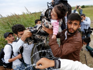 Desperate Migrants Fleeing War and Poverty Seek Refuge in Europe