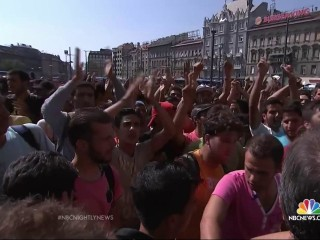 Migrants Who Escaped ISIS, War and Syria Chant 'We Are Human'