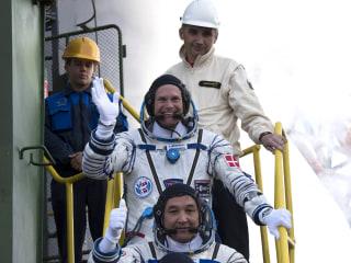 Three-Man International Crew Safely Reaches Space Station