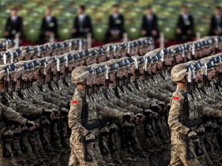 China to Cut Military by 300,000 Troops, President Xi Says at Parade