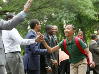 A Hundred Black Men High-Five Students on First Day of School
