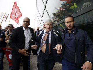 Air France Execs Lose Shirts as Union Activists Attack