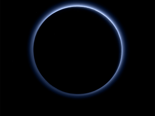 Blue Haze Surrounds Pluto in New Image
