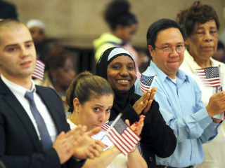 New Citizens Sworn in at Emotional Naturalization Ceremonies