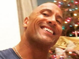 Dwayne Johnson Totally Rocks Daughter's Diaper Change in Cute Pic
