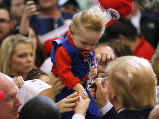 Donald Trump Autographs a Child in Baton Rouge