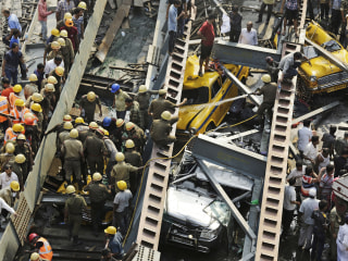 Rescuers Dig Through Rubble of Overpass Collapse in India