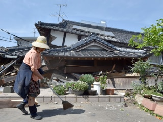 Japanese Pick Up Pieces After Deadly Earthquake