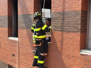 NYC Firefighter Proposes Midair While Hanging From a Building