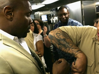 Navy Relaxes Tattoo Restrictions Allowing More Art on Neck, Legs and Arms