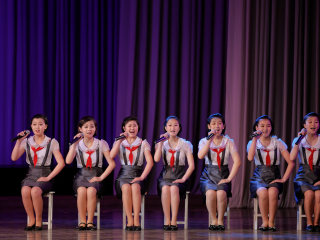 North Korean Children Perform Song and Dance for Foreign Press