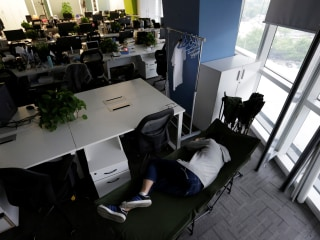 China's Tech Employees Work, Eat and Sleep in Their Offices
