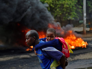 Kenyans Flee Past Burning Barricades as Protesters Clash With Police
