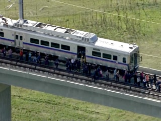 Broken Cable Strands 80 Train Passengers 50 Feet Up in Denver