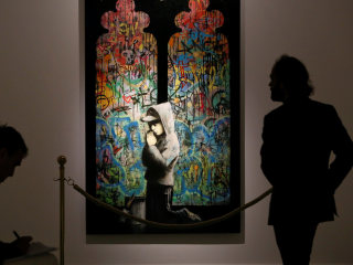 'Unprecedented' Banksy Exhibition Opens in Rome's Palazzo Cipolla Museum