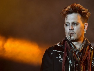 Johnny Depp Rocks Out at Concert Amid Wife Amber Heard's Abuse Allegations