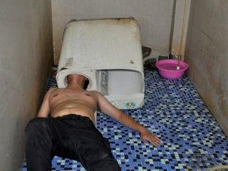 Chinese Man Traps Head Inside Washing Machine