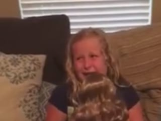 Girl Cries Tears of Joy at Doll With Prosthetic Leg