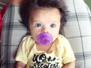 Baby's 'Glamorous' Head of Hair Charms Internet