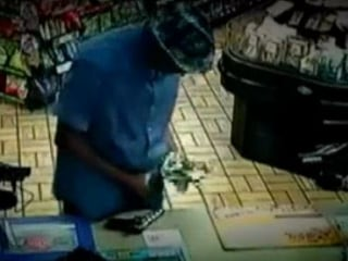 'Polite' Gunman Hunted Over 24 Robberies in 2 Weeks