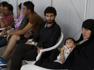 As Refugee Crisis Grows, U.S. Strains Under Asylum Backlog, Report Says
