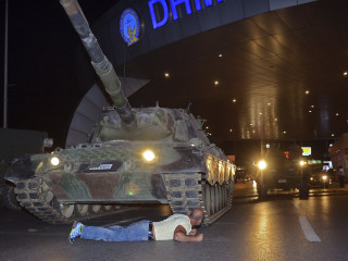 Dramatic Image Shows Man Lying in Front of Tank in Turkey