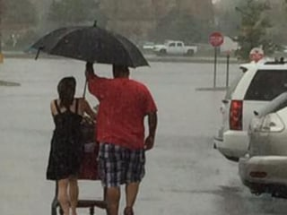 See How This Man Warmed the Hearts of Many - With Only an Umbrella