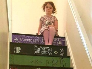 Woman steps up her love for books with beautifully hand-painted staircase