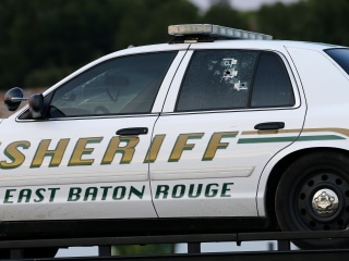 Police Investigate the Scene of Baton Rouge Shootings