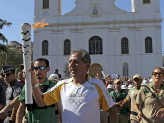 Olympic Torch Met by Protests in Rio Town
