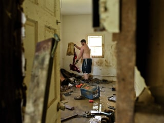 Louisiana Residents Assess Flood Damage, Salvage Belongings
