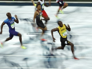Olympic Moments: Bolt Cruises to Third  200m Gold and More